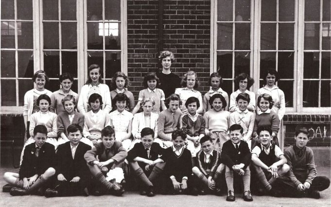 1957 1st year at St Chads - Back row - Margaret O'Neill, Hazel Constable, Linda Wilson, Iris Powell, Christine Talbot, Music Teacher Miss Trussler, Lynette Morrell, Brenda Reeves, ?, Antonia McQuaid.     Middle row - Jean McCabe, Doreen Horsnell, Carol Parfrey, Sandra Wakeling, Valerie Little,  Brenda Garwood, Jackie Cook, ?, Maria Dichomedes, Valerie Parchment, Carol Cox.    Front row - Terry Keeble (Twin), Terry Dowman, Paul Carter, Tony Keeble (Twin), Peter Taylor, Freddy Shepherd, Michael (Biffo) Byford, David (Monty) Hale, Cliff Cowin. | Cliff Cowin