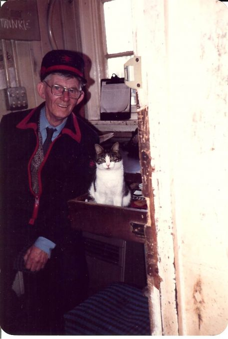 Bill Cowin with station cat in Ticket Collecters box Tilbury Riverside Station c1970