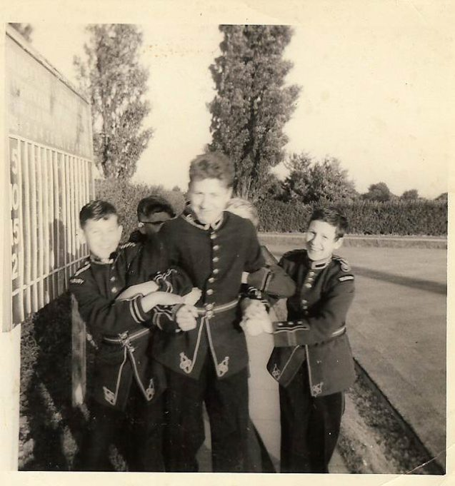 Young bandsmen larking around c1960. Notice the military style uniforms
