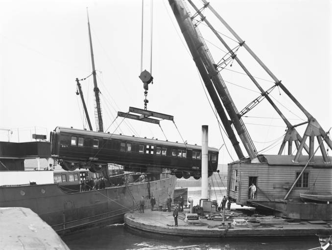 Ambulance carriage being loaded for shipment to the Western Front, at Tilbury dock 1916.