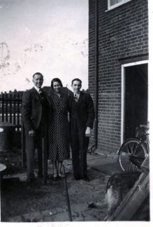 Victor & Len with mother outside house