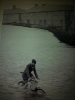 Peter Jennings cycles through the floods