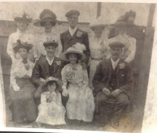 This is a photo of Minnie and George's wedding at St Mary's Little Thurrock. They are the couple in the middle front row. Unsure of anyone else.