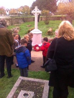 Children from Chadwell and Woodside Primary Schools gather round the Chadwell war memorial | John Matthews