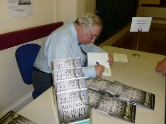 Richard Burrell signing copies of the book | Annie O'Brien
