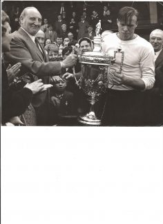 Ginger Shulver accepting the cup for the team