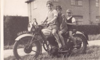 Boys on motor bike in Brennan Road