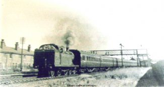 A train passes Railway Cottages | from John Smith