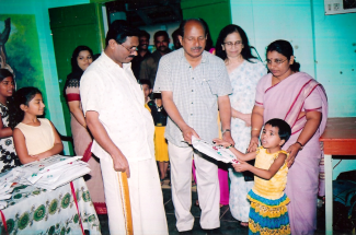 Dr Ram presenting uniform, wife Rema, teachers & pupils. Dr Rams daughters Ratheetha & Remina pictured far left. | Dr Ram